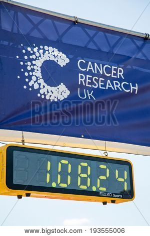 Southampton, Uk - 2 July 2017: Race for Life banner and race timer. This annual race is run by women to raise money for Cancer Research and to honour those who have died or suffer  from the disease.