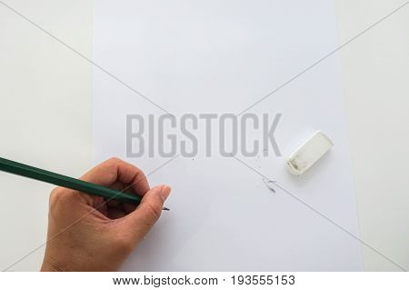 isolated close up people re-write on mock up paper after use rubber