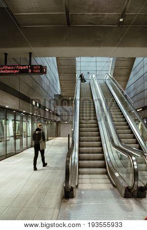 Copenhagen Denmark - August 12 2016: People using escalators in the subway of Copenhagen. Blur motion