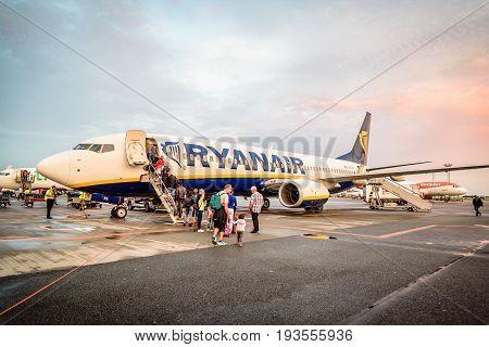 Copenhagen Denmark - August 12 2016: Passengers boarding a Ryanair Boeing B737 in Copenhagen airport. Near sunset