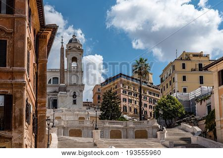 Rome Italy - August 18 2016: Piazza di Spagna and spanish steps to Piazza della Trinita dei Monti with no people a sunny summer day. It is a main square in the historical centre of Rome.