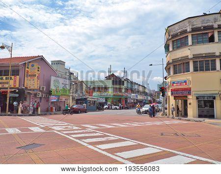 Penang, Malaysia - May 12, 2017: The junction of Lebuh Chulia with Jalan Masjid Kapitan Keling (formerly Pitt Street) in George Town, Penang, Malaysia.