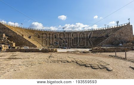 The ruins of the ancient amphitheatre in Caesarea lit by the morning sun. Israel.