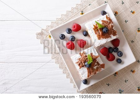Chocolate Millefeuille With Berries Close-up On A Plate. Horizontal Top View