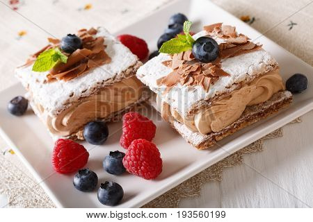 Delicious Chocolate Millefeuille With Raspberry And Blueberry Close-up. Horizontal