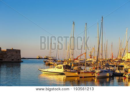 Heraklion, Greece, June 10, 2017: Old Harbour Of Heraklion With Fishing Boats And Marina During Twil