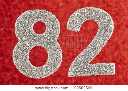 Number eighty-two silver color over a red background. Anniversary. Horizontal