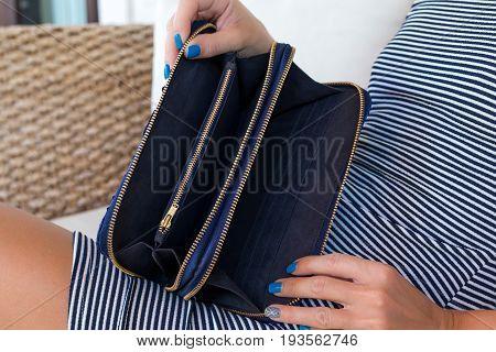 Luxury snakeskin wallet purse in woman hands. Bali island, handmade purse.