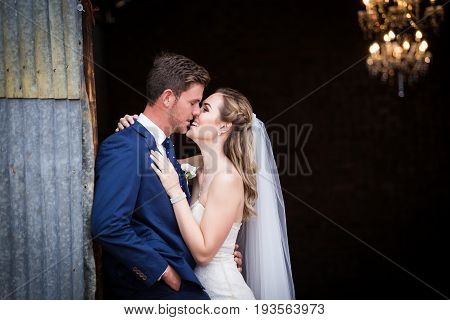 Beautiful Bride And Her Groom On Their Wedding Day Looking Happy And In Love At The Start Of Their M