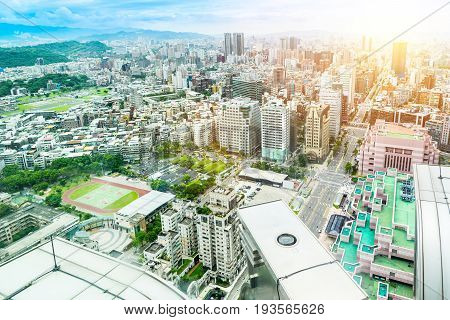 Asia Business concept for real estate and corporate construction - panoramic modern cityscape building bird eye aerial view inside Taipei 101 building itself under sunrise and morning blue bright sky shot in Taipei 101 Taiwan