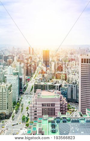 Asia Business concept for real estate and corporate construction - panoramic modern cityscape building bird eye aerial view with World Trade Center in morning blue bright sky in Taipei Taiwan