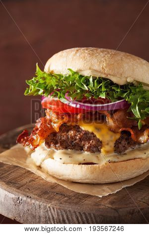 bacon cheese burger with beef patty, tomato, onion