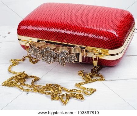 Red Handbag Clutch With Chain On White Background