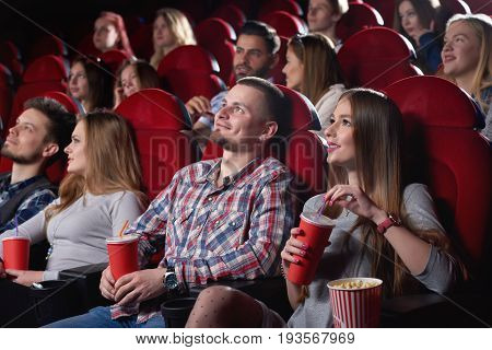 Shot of cinema auditorium full of spectators enjoying watching a movie people lifestyle leisure entertainment happiness positivity emotions concept.