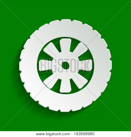 Road tire sign. Vector. Paper whitish icon with soft shadow on green background.