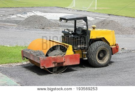 Soil Compactor During Construction Work In Football Stadium