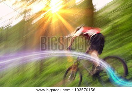 Low angle view of a blurred male cyclist on countryside track
