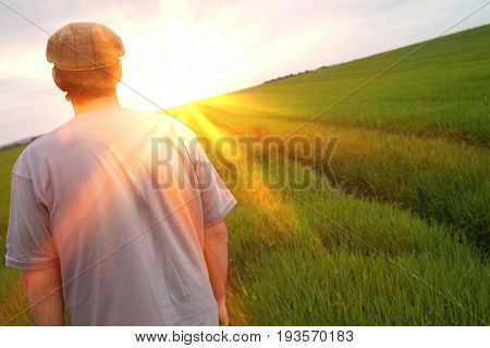 Rear view of a man standing in tilt field