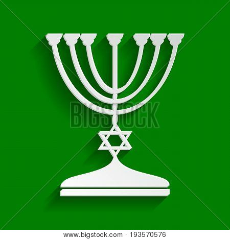 Jewish Menorah candlestick in black silhouette. Vector. Paper whitish icon with soft shadow on green background.