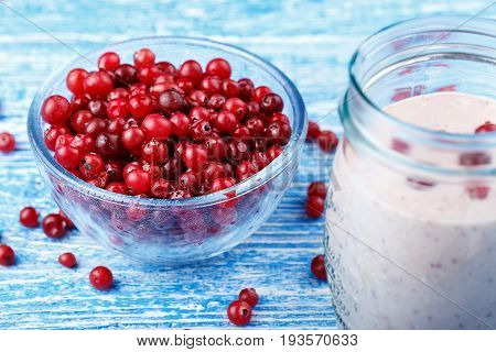 healthy nutritious breakfast with milk cottage cheese and cranberry - Cranberry smoothie in a glass
