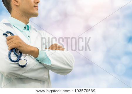 Male Doctor Holding Stethoscope In The Hospital