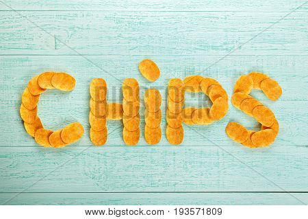 Laid inscription of potato chips - chips. crispy snack to beer. Top view.