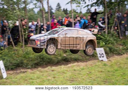 Mikolajki, Poland - 29 June 2017: Hayden Paddon and his codriver Sebastian Marshall Hyundai Motorsport in a Hyundai i20 Coupe WRC race in the 74nd Rally Poland, on June 29, 2017 in Mikolajki, Poland.