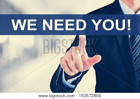 Businessman hand touching WE NEED YOU! message on virtual screen