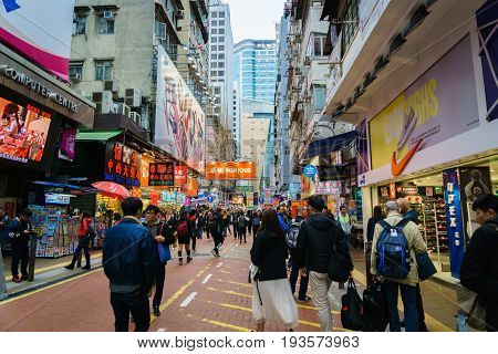 Hong Kong, China - March 2017: Mong Kok district, Hong Kong. crowded shopping street in Kowloon where you can see many tourists and local people.
