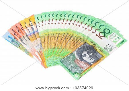Money Australian dollar (AUD) banknotes spread out on white background