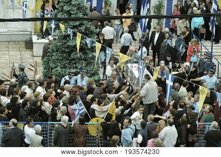 Pilgrims from around the world passing under the coffin with relics of St. John the Russian. May 27 2005 - Prokopi, Evia, Greece