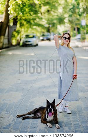 Girl With Dog Pit Bull Terrier On A Walk.