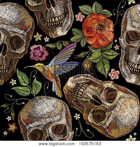 Embroidery skull and roses humming bird and flowers seamless pattern. Dia de muertos art day of the dead. Gothic embroidery human skulls and red roses clothes template and t-shirt design