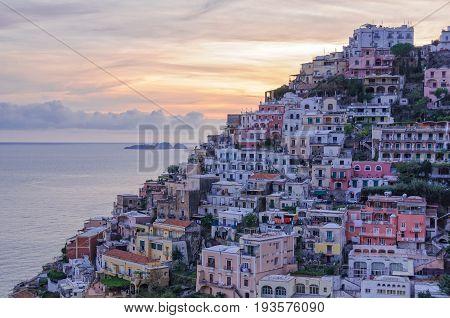 Colorful houses on the slopes of Positano and the Gallo Lungo island on the horizon - Amalfi Coast, Campania, Italy