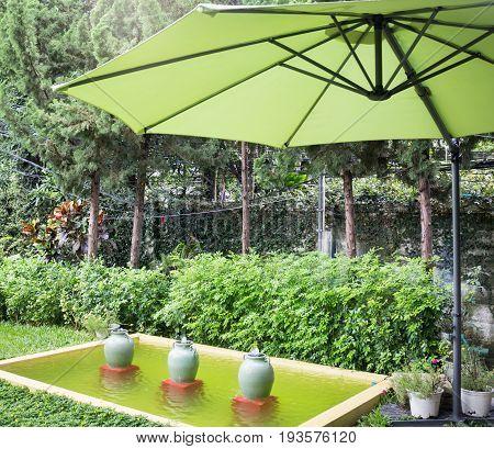 Flaxen garden umbrella in summer