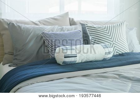 White Bolster And Pillows On Bed In Modern Classic Bedroom Interior