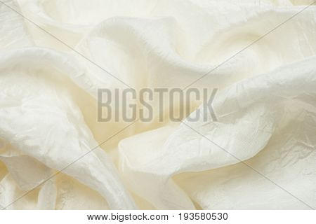 Texture of wrinkled ivory silk. Abstract background