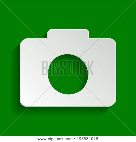 Digital camera sign. Vector. Paper whitish icon with soft shadow on green background.