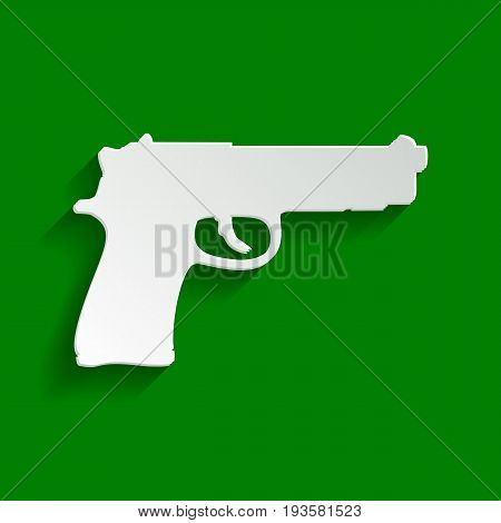 Gun sign illustration. Vector. Paper whitish icon with soft shadow on green background.