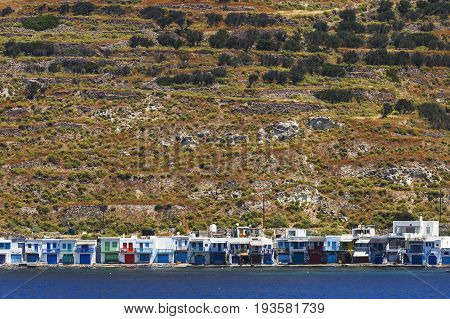 Klima village on the coast of Milos island as seen from the ferry.