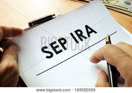 SEP IRA (Simplified Employee Pension) written on a paper. poster