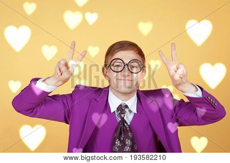 Nerd in studio with heart background