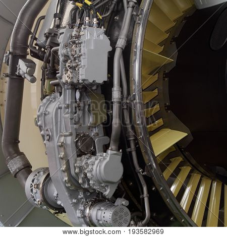 Part of a modern turbofan aircraft engine closeup.