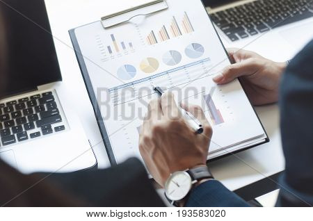 Businessmen working at office with laptop data spreadsheet documents