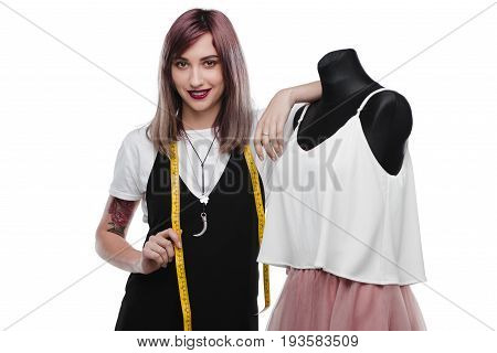 Beautiful Dressmaker With Purple Hair Posing With Measuring Tape And Dummy, Isolated On White