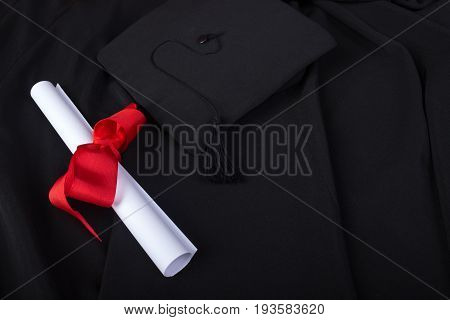 Graduation Day. A Gown, Graduation Cap, And Diploma And Laid Out Ready For Graduation Day