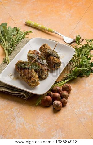 veal rolled up breaded with hazelnuts