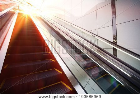 Escalator with large sun beam