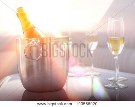 Flutes with champagne bottle in ice bucket on table