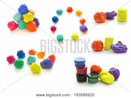 Modeling clay balls of different colors isolated on a white background
